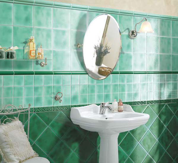 the small curvy design in this green bathroom adds a bit of elegance
