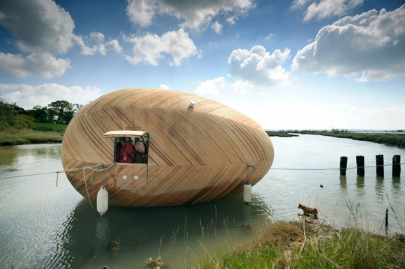 traveling-down-the-river-in-this-egg-boat-1