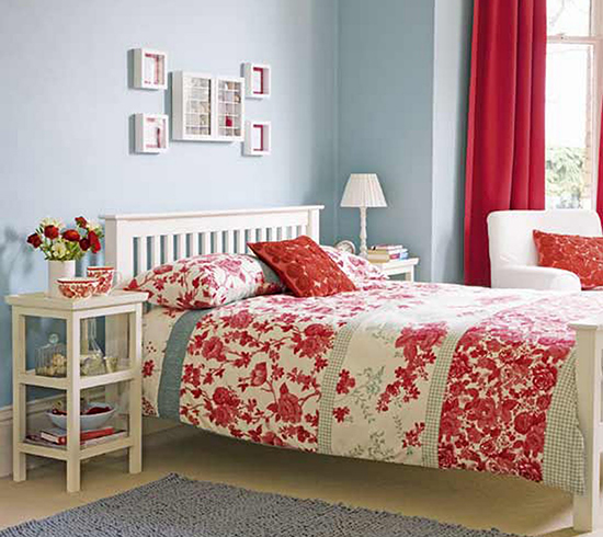 Bed with bedding on red flowers