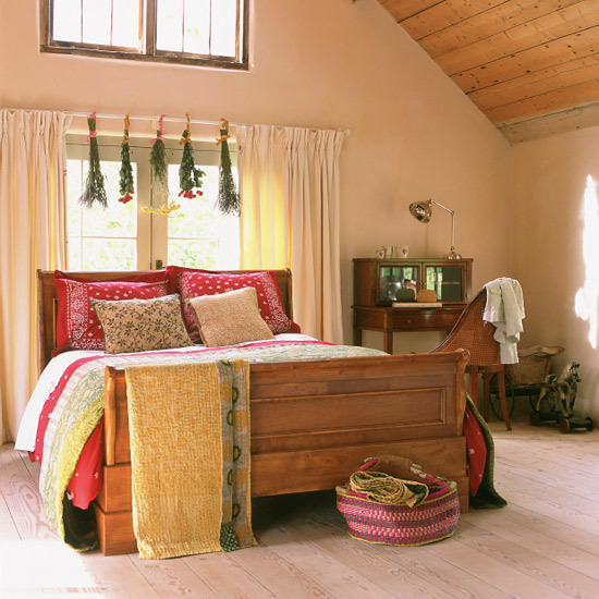 Country bedroom with herbs hanging from above
