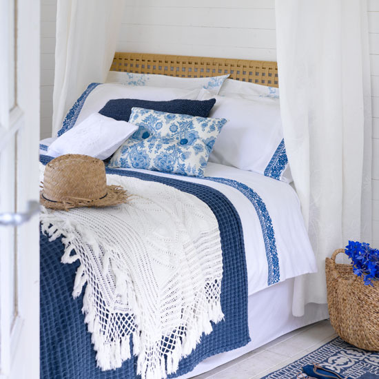 Country bedroom in blue and white colors