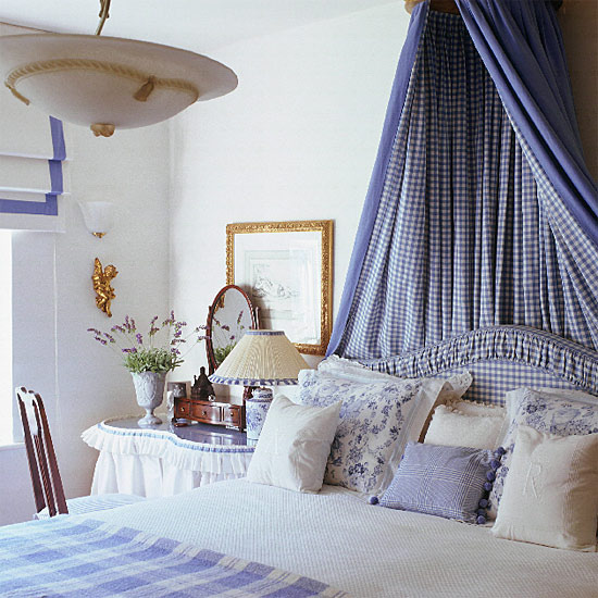 Cozy bed with blue bedding
