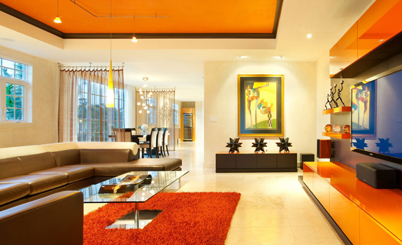 Modern living room with orange accents