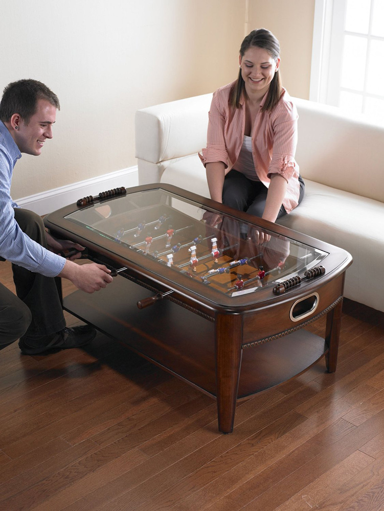 People playing on the foosball coffee table