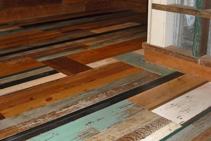 The trendy painted reclaimed wood flooring