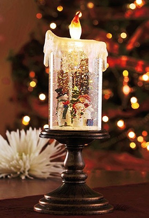 Candle shaped snow globe in action