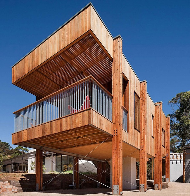 Modern beach house built with natural materials