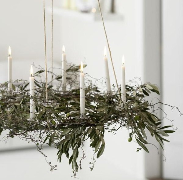 Chandelier from candles and branches