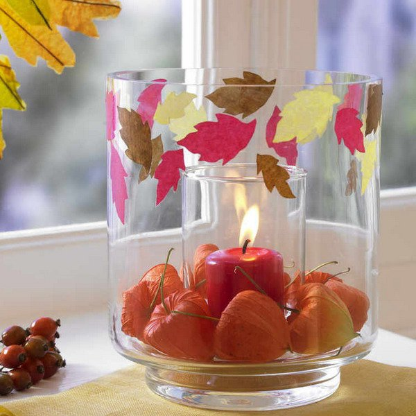 Bowl with apples and a candle