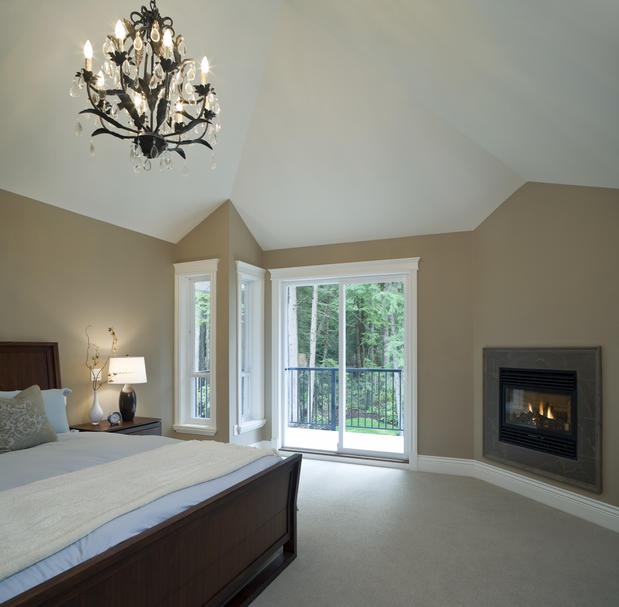 Bedroom with built-in fireplace
