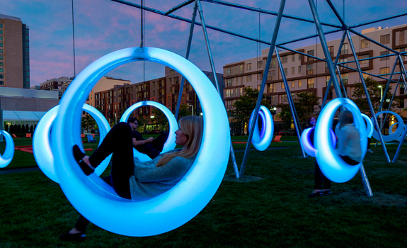 Glowing ring-shaped swings