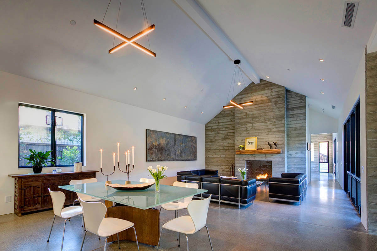 Open plan living area with concrete fireplace