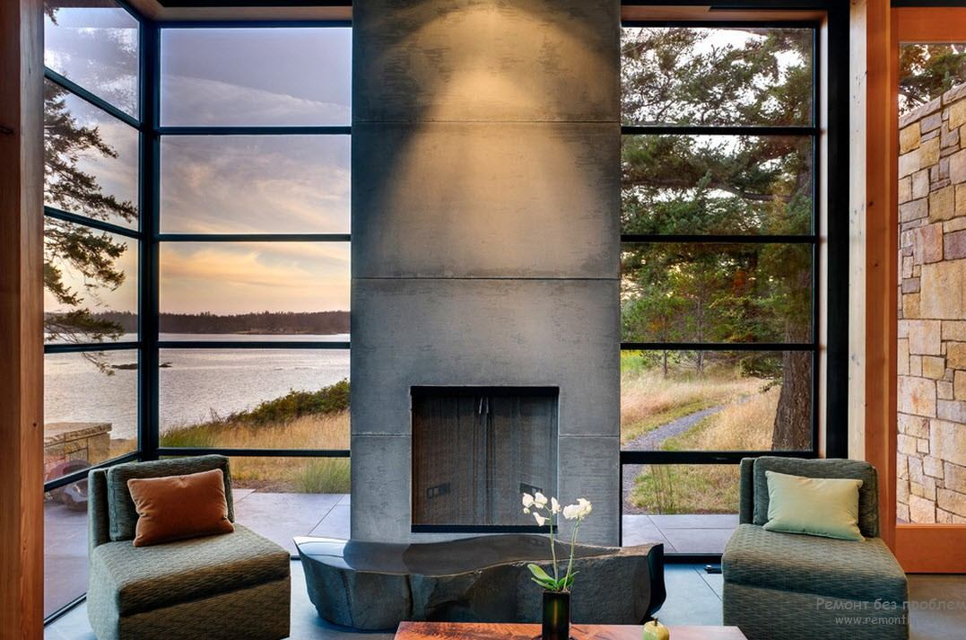 Contemporary living room with concrete fireplace
