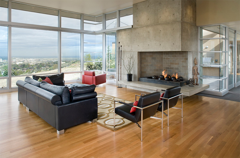 Modern living room with concrete fireplace