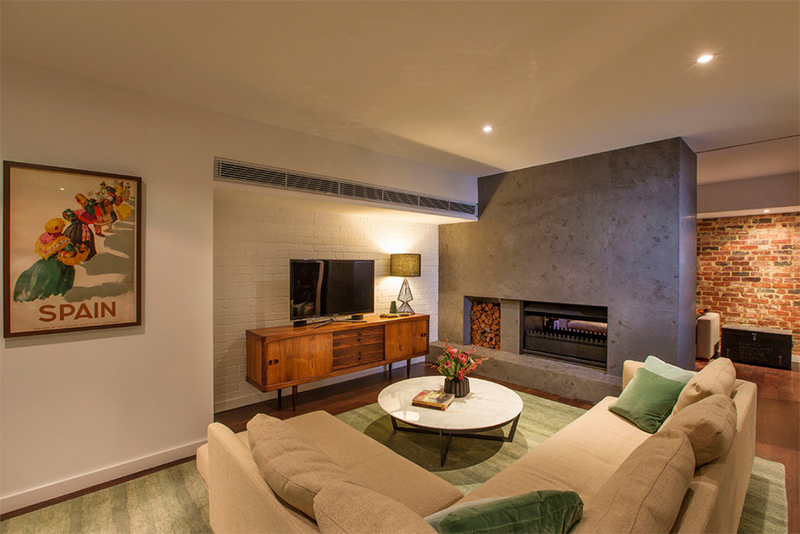 Traditional living room with concrete fireplace