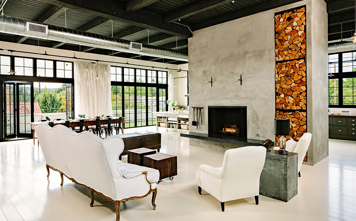 Spacious living room with concrete fireplace