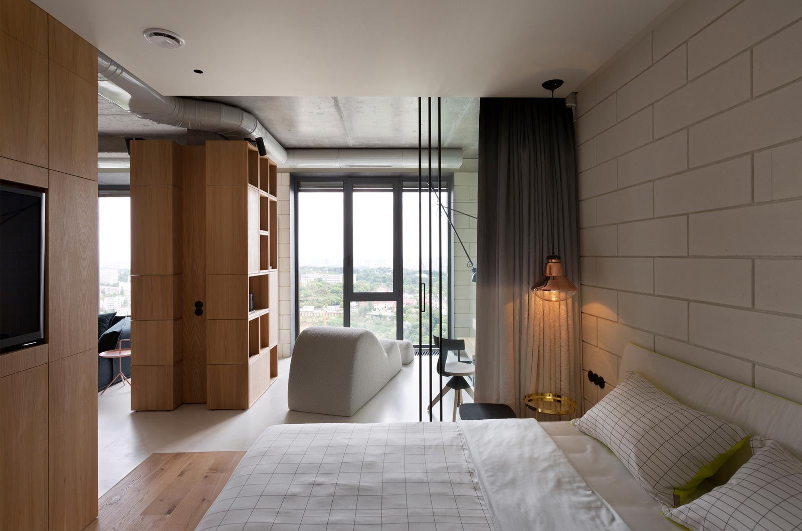 Contemporary bedroom with large windows