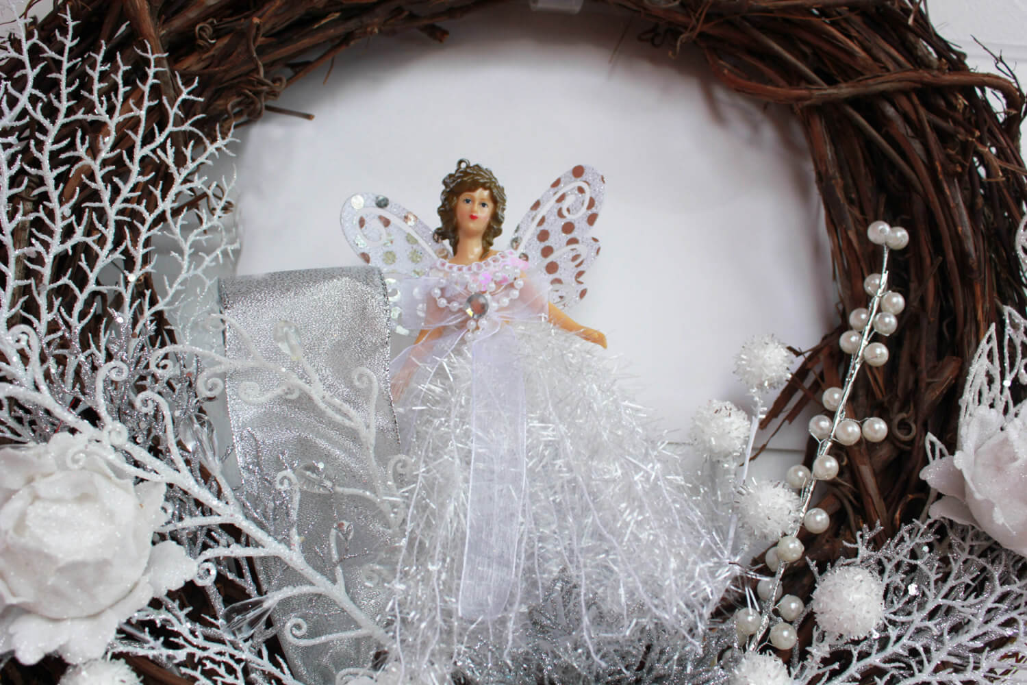 Christmas wreath with a white angel