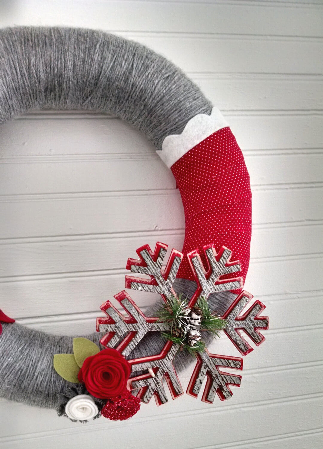Christmas wreath in white, red and gray with a snowflake