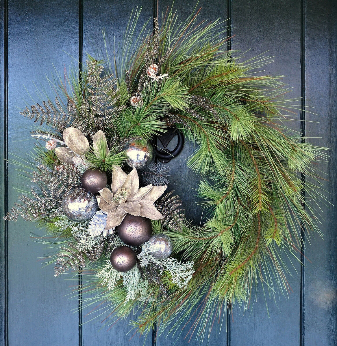 Sparkling pine, poinsettia and ornament wreath