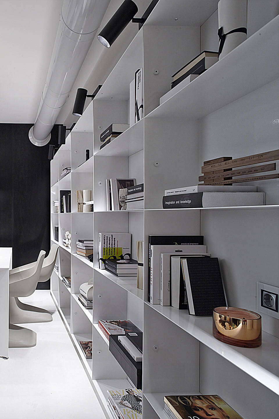 White rectangle shelves on the wall