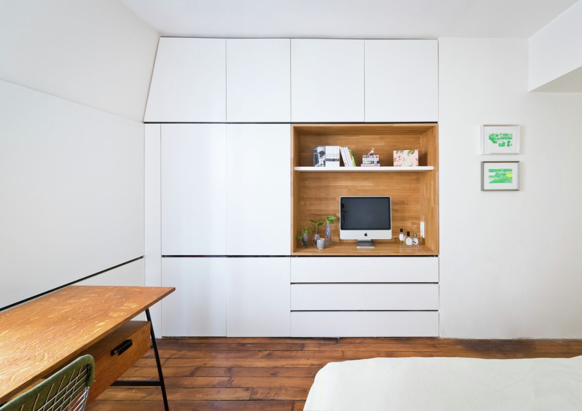 White bedroom with wooden features