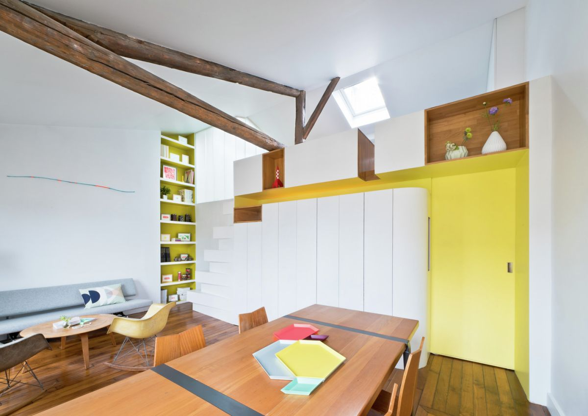 Living room with wooden furnishings and yellow accents