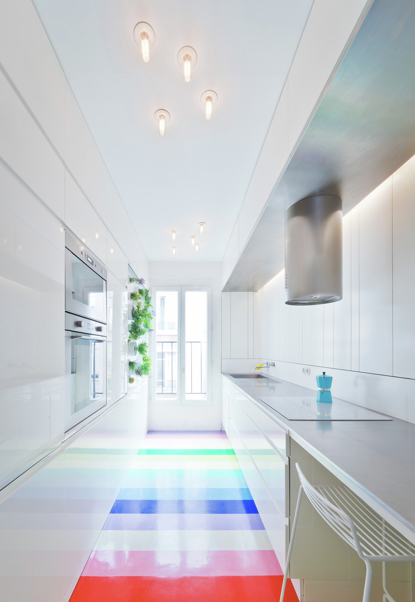 All white kitchen with colorful flooring