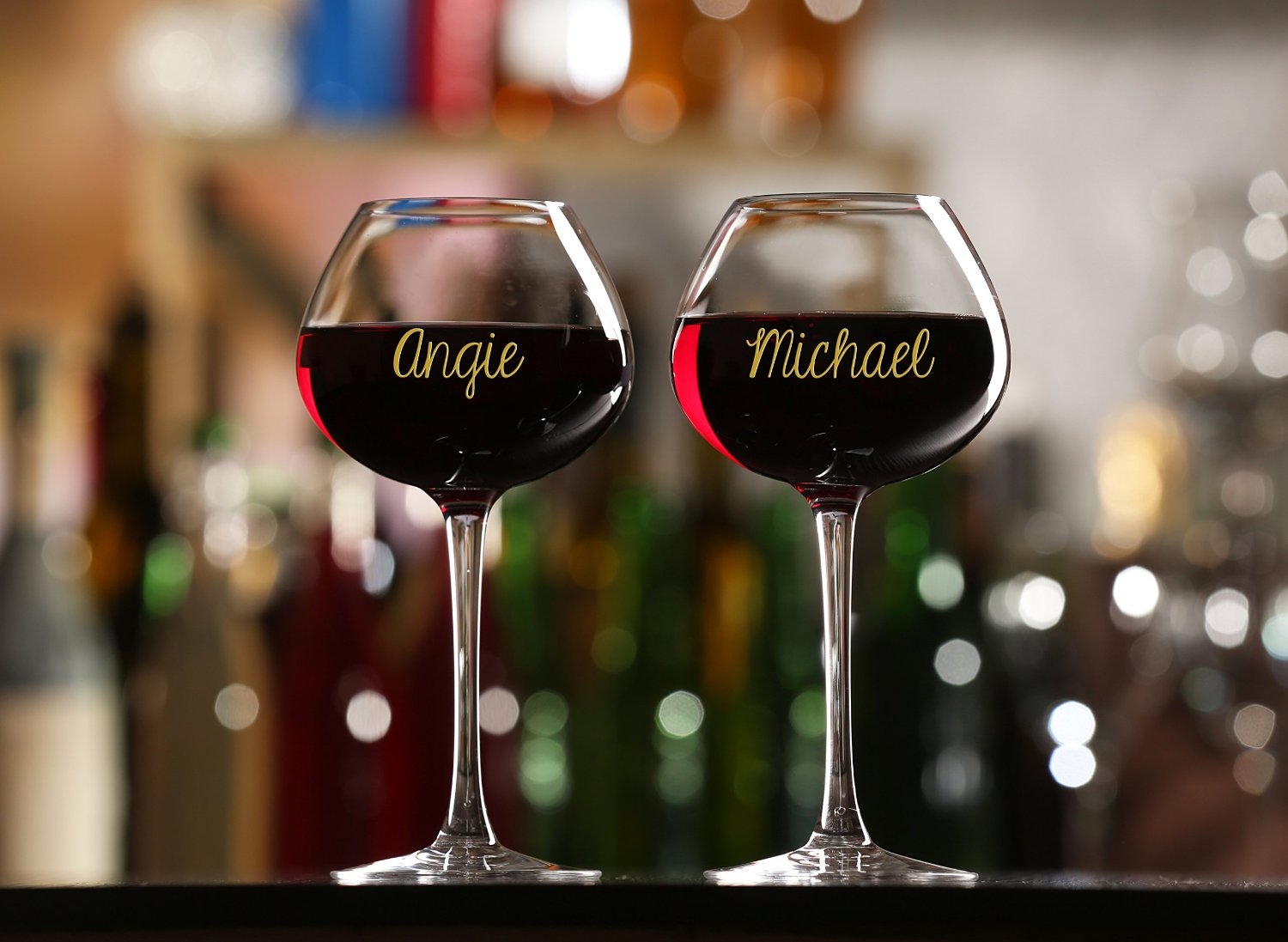Names written with marker on wine glasses