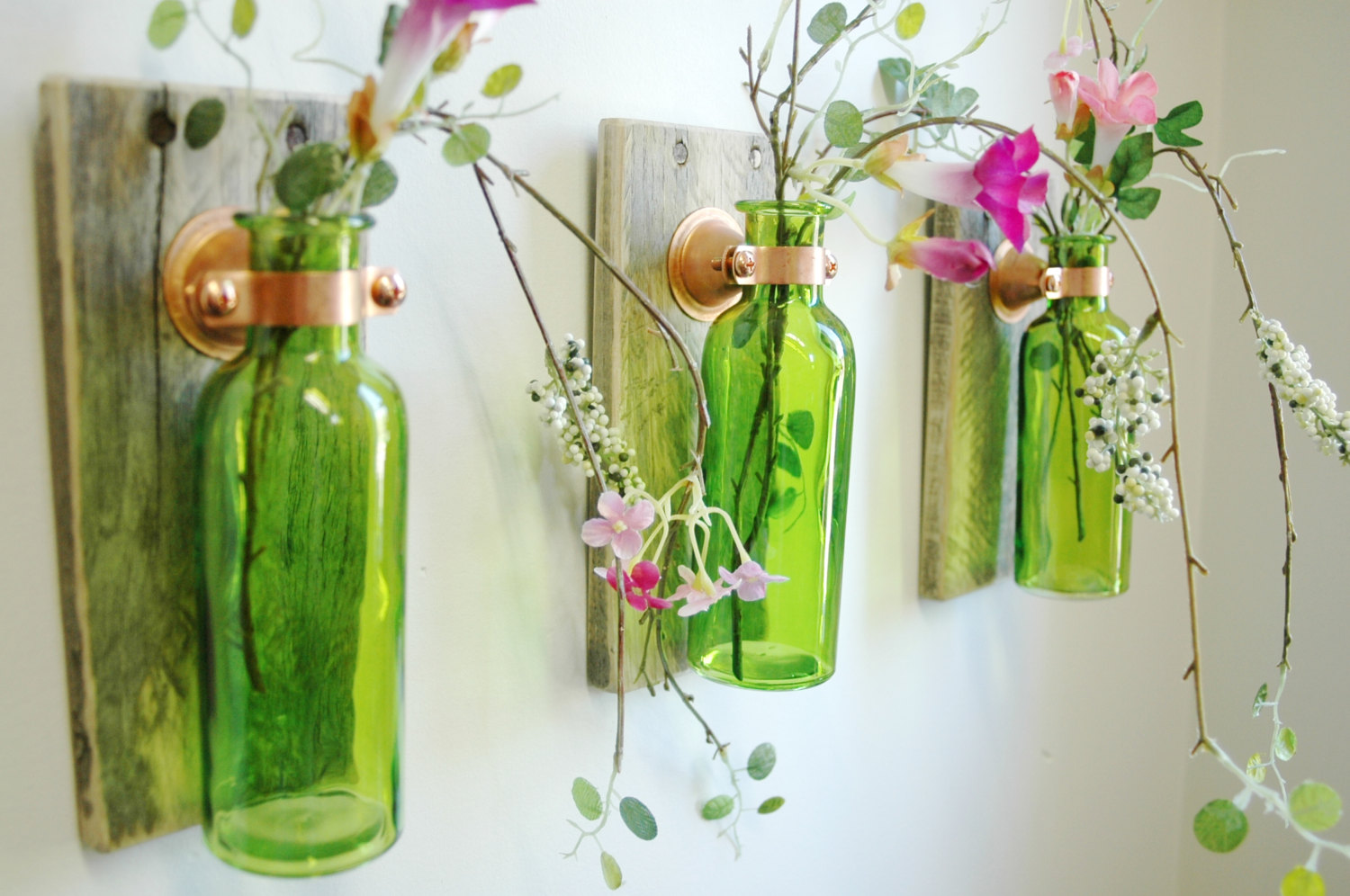 Wall decoration with green bottles