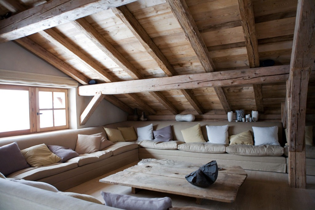 Attic living room with a wooden roof