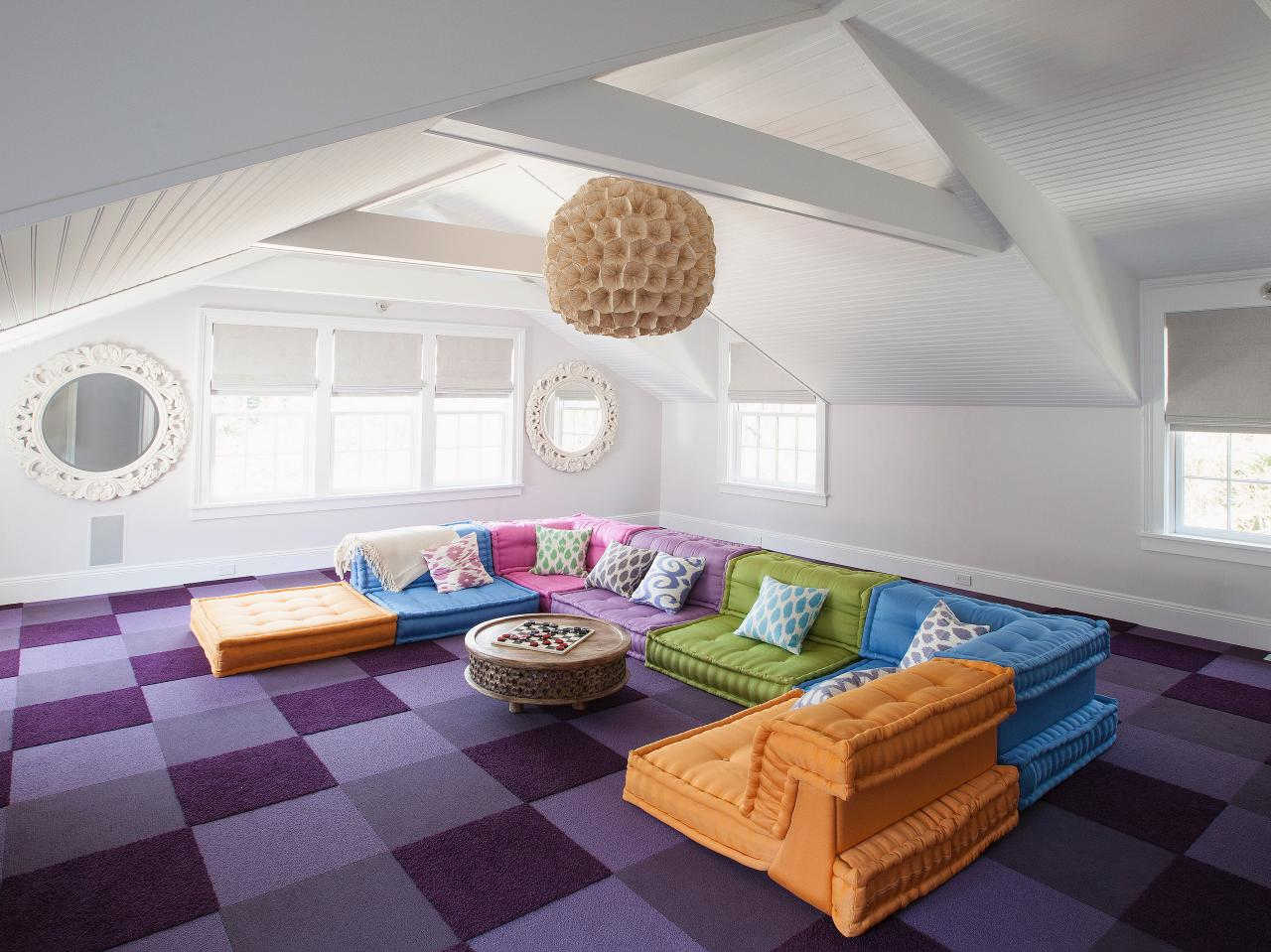 White attic living room with colorful carpet and furniture