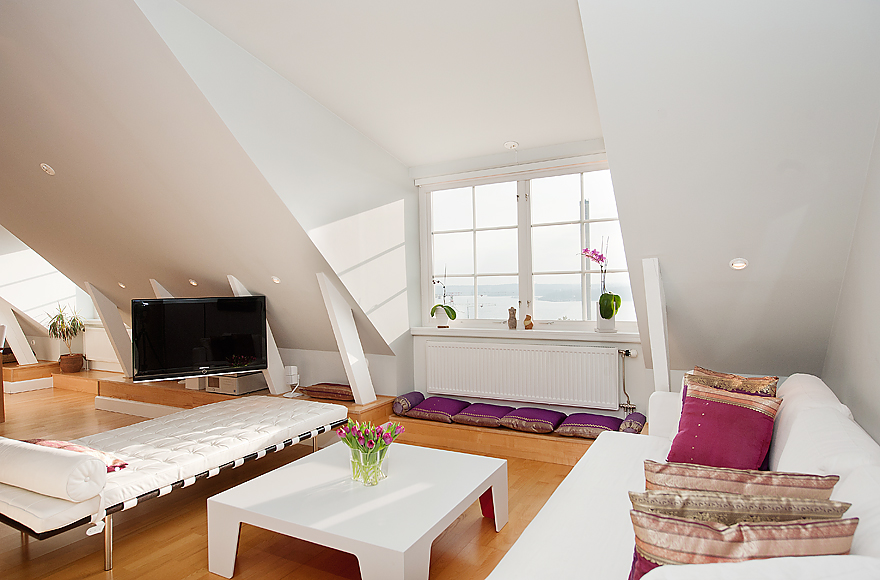 White Attic Living Room With Wooden Floors