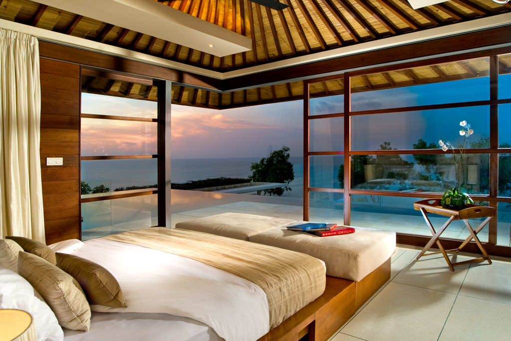Luxury tropical bedroom with glass walls