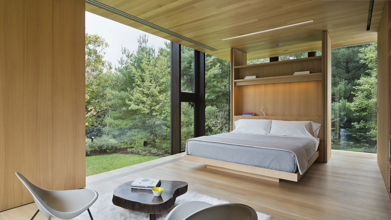 Wooden bedroom with forest view