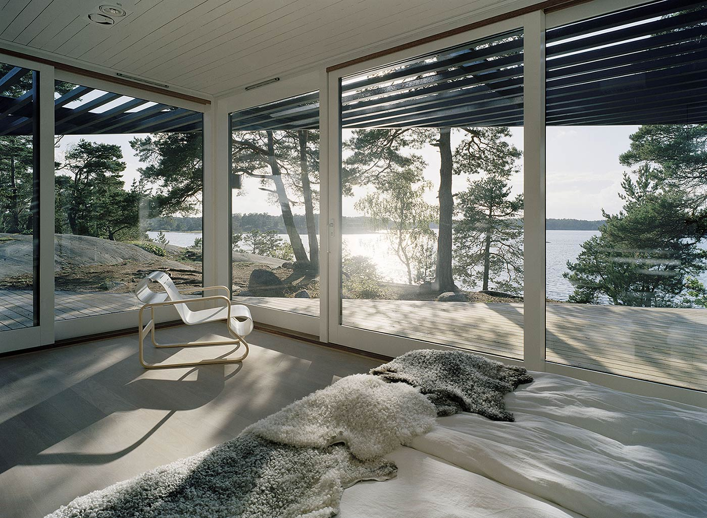 Bedroom With a Glass Wall and Sea View