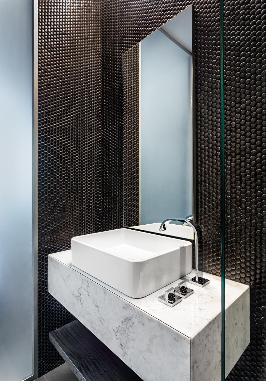 Dark bathroom with white sink