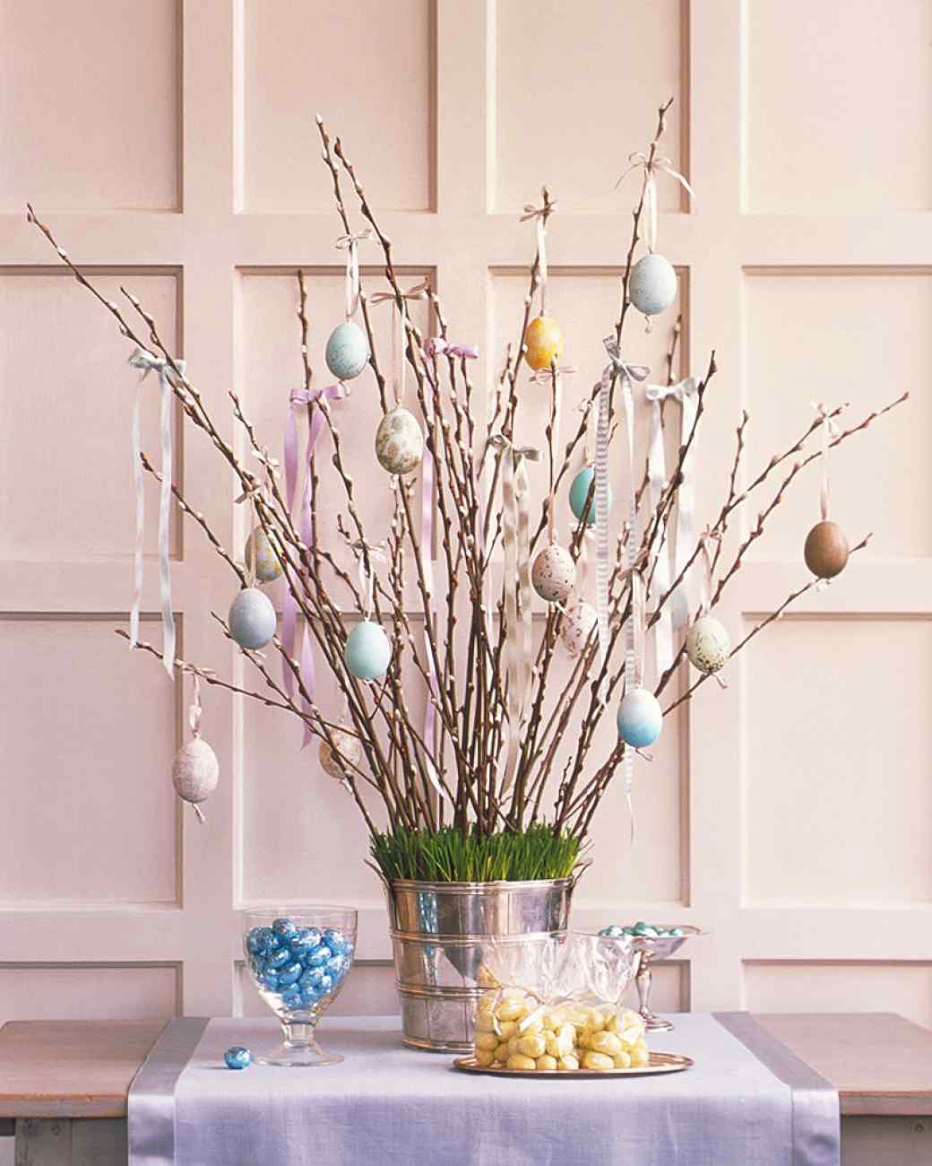 Easter table decoration with branches and eggs