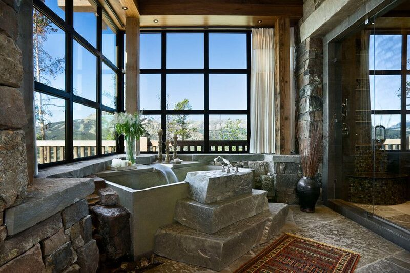 Rustic bathroom with stone tub