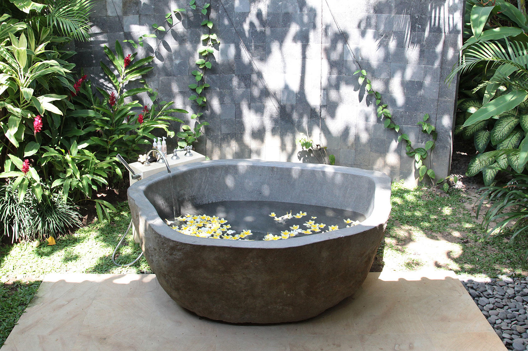 Stone bathtub in the backyard