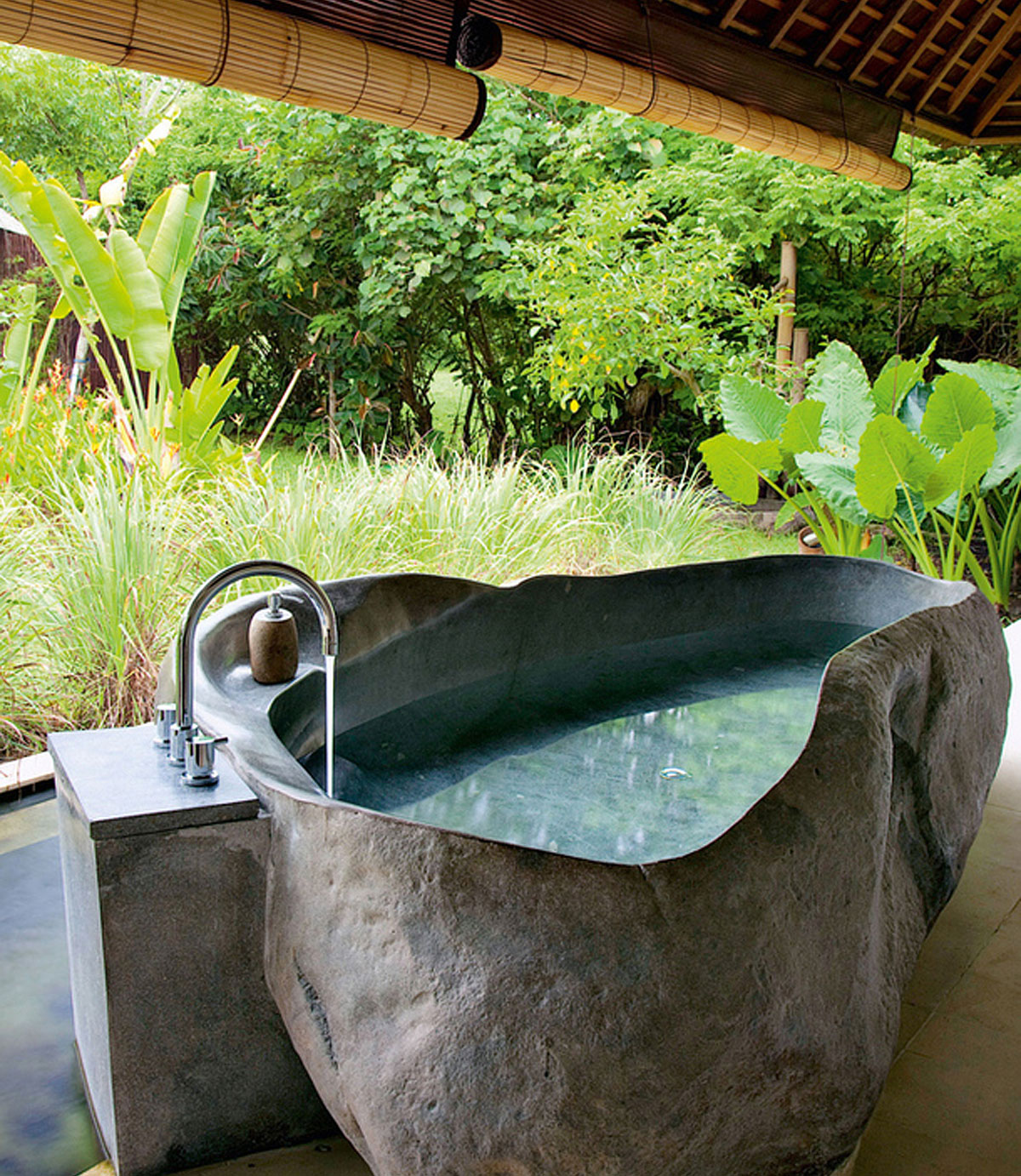 stone bathtub with organic shape. Black Bedroom Furniture Sets. Home Design Ideas