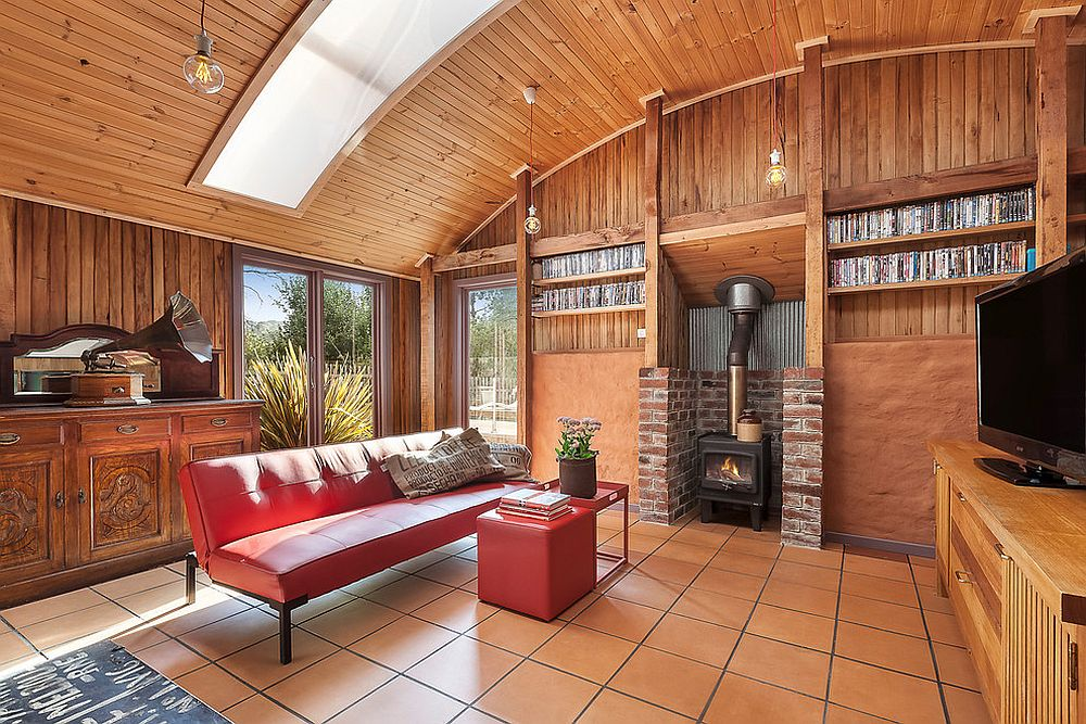 Wooden living room with a red sofa