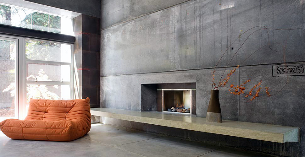 Concrete wall with a built in fireplace in a custom home by Fu-Tung Cheng