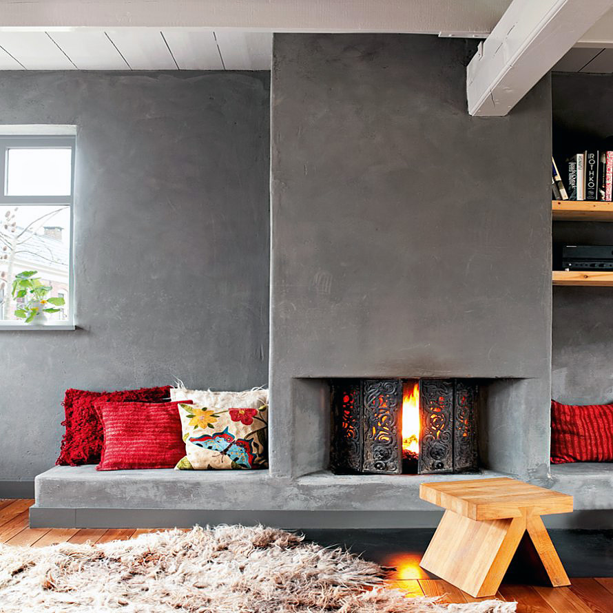 Concrete fireplace in a cozy living room