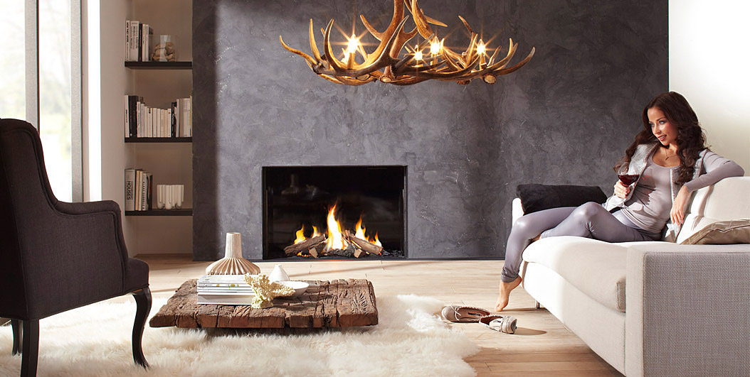 Concrete wall with a built in fireplace in a cozy decorated living room