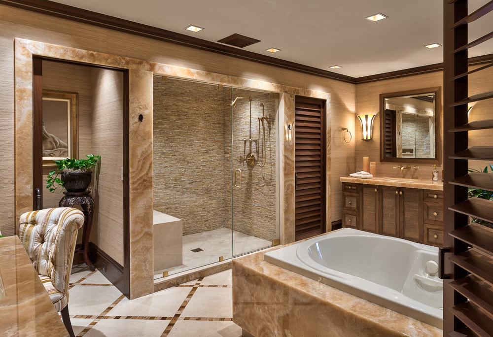 Modern luxury bathroom with granite bathtub and glass shower enclosure