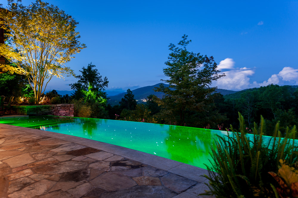 Mountain infinity pool by night