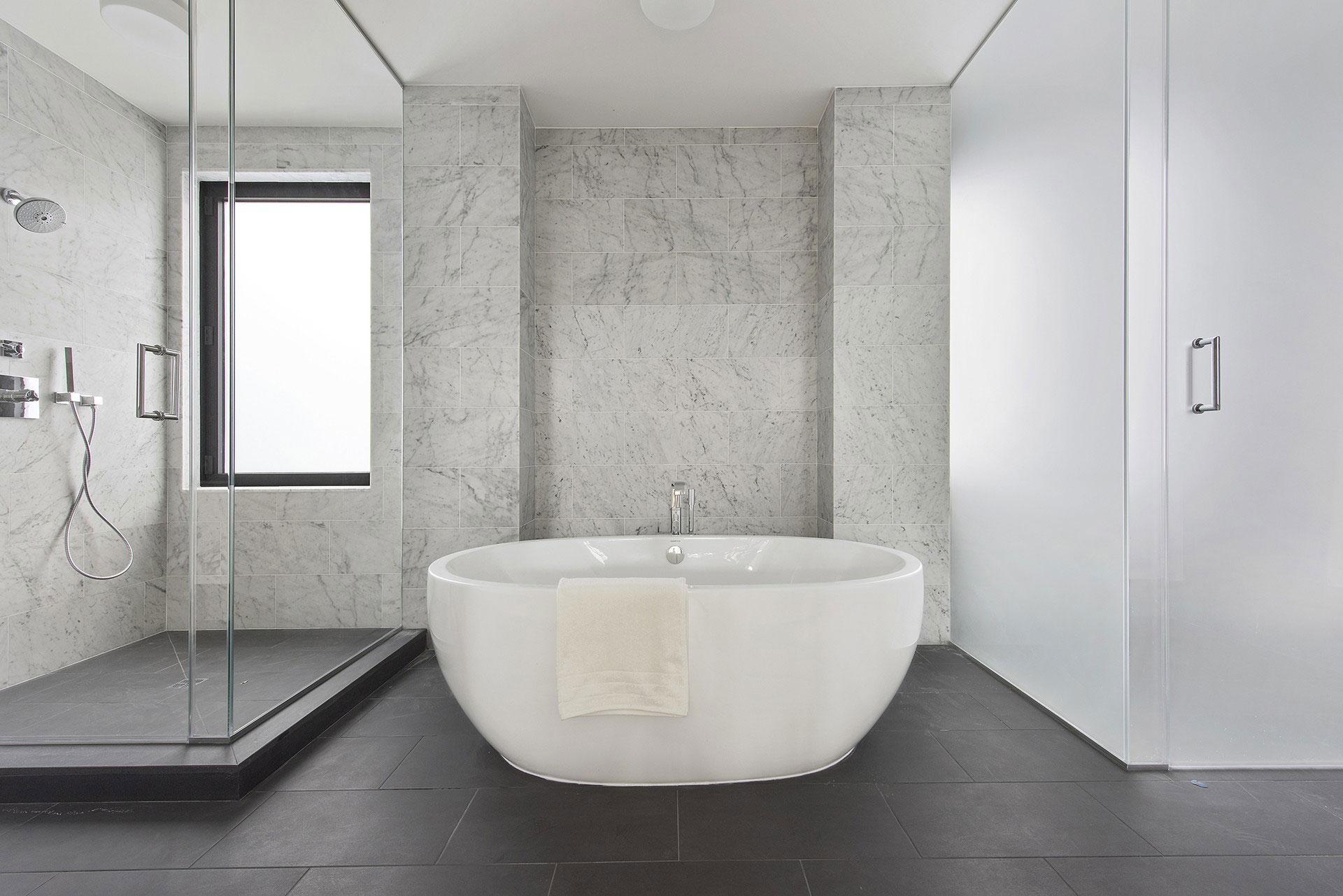 Marble bathroom with a tub