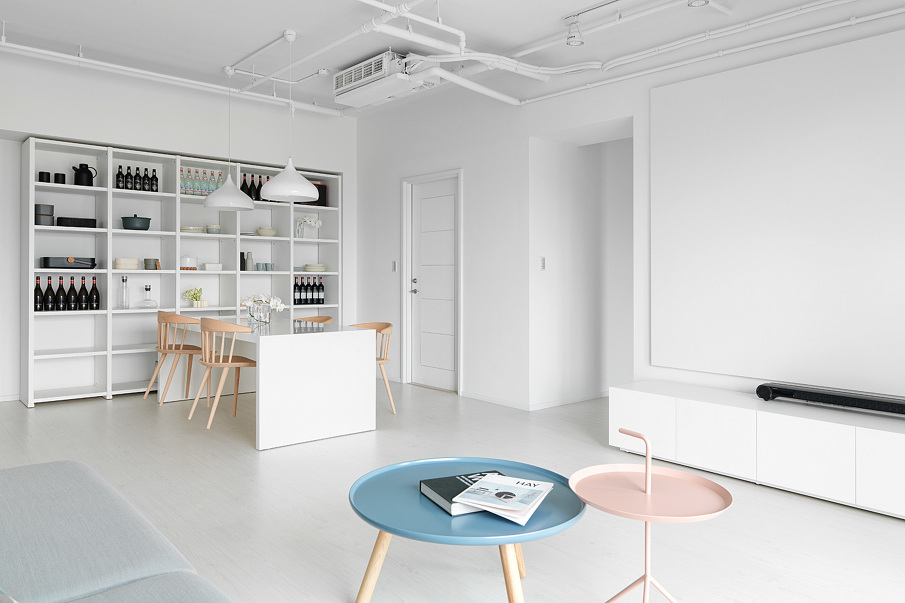 White interior with pastel coffee table