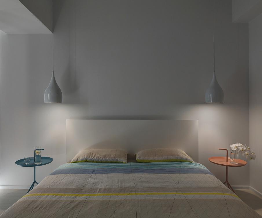 Minimalist white bedroom by night